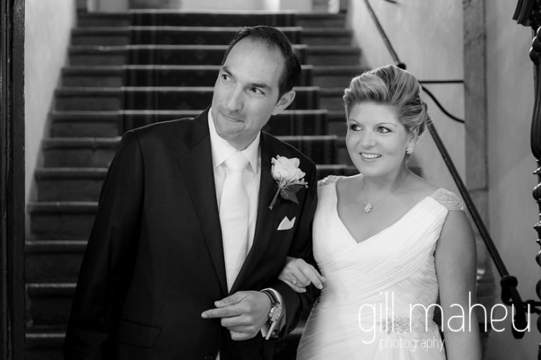 black and white of wedding couple coming down stairs at Abbaye de Talloires, Annecy wedding by Gill Maheu Photography, photographe de mariage