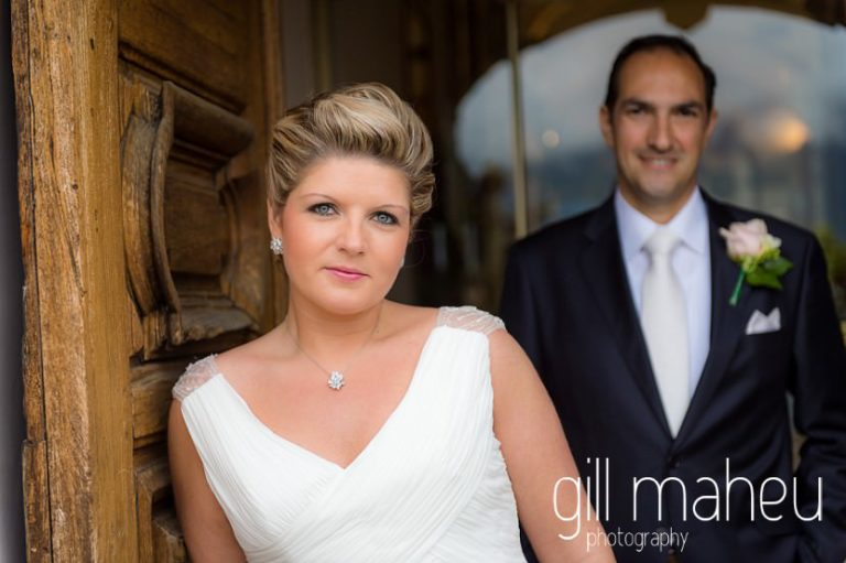 bride and groom in entrance hall arch of the Abbaye de Talloires, Annecy wedding by Gill Maheu Photography, photographe de mariage
