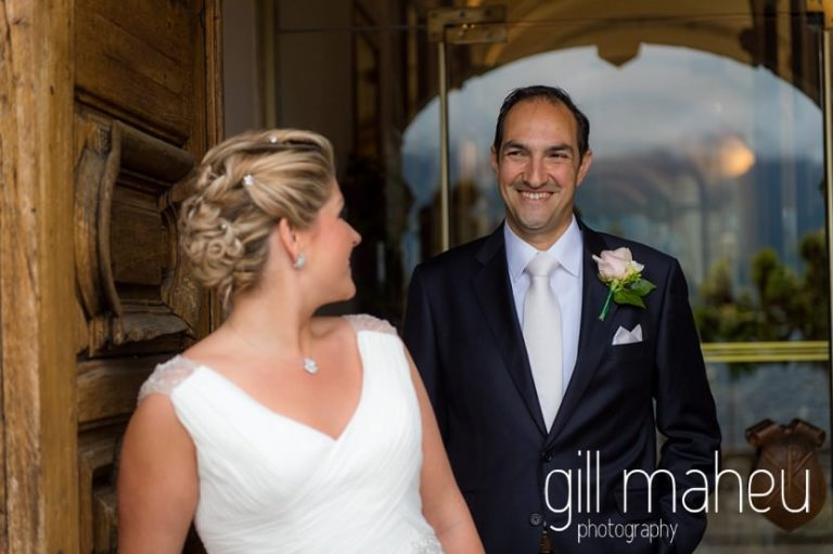 bride looking back at groom in entrance hall of the Abbaye de Talloires, Annecy wedding by Gill Maheu Photography, photographe de mariage