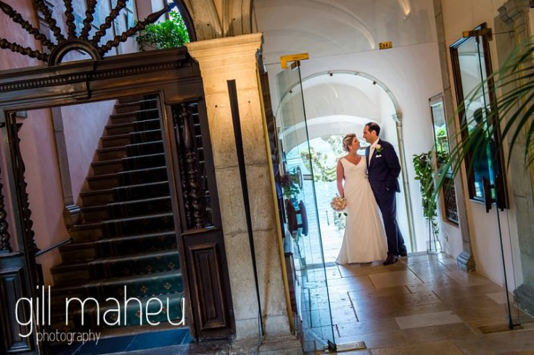 bride and groom in entrance hall at Abbaye de Talloires, Annecy wedding by Gill Maheu Photography, photographe de mariage