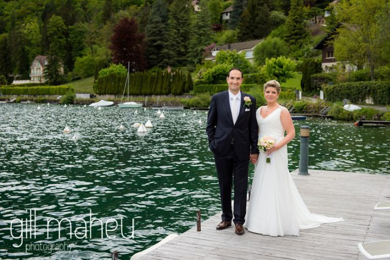 bride and groom walking along the lake ponton jetty at the Abbaye de Talloires, Annecy wedding by Gill Maheu Photography, photographe de mariage