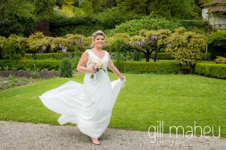 bride twirling in beautiful pronovias wedding dress in the gardens of the Abbaye de Talloires, Annecy wedding by Gill Maheu Photography, photographe de mariage