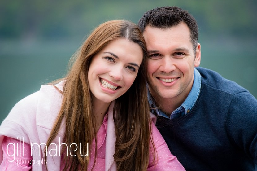 close up portrait of bride and groom on jetty in front of Talloires, Annecy engagement session by Gill Maheu Photography, photographe de mariage