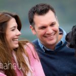 close up portrait of bride and groom laughing on jetty in Lake Annecy opposite Talloires, engagement session by Gill Maheu Photography, photographe de mariage