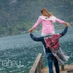 bride on groom's shoulders on jetty in Lake Annecy opposite Talloires, engagement session by Gill Maheu Photography, photographe de mariage