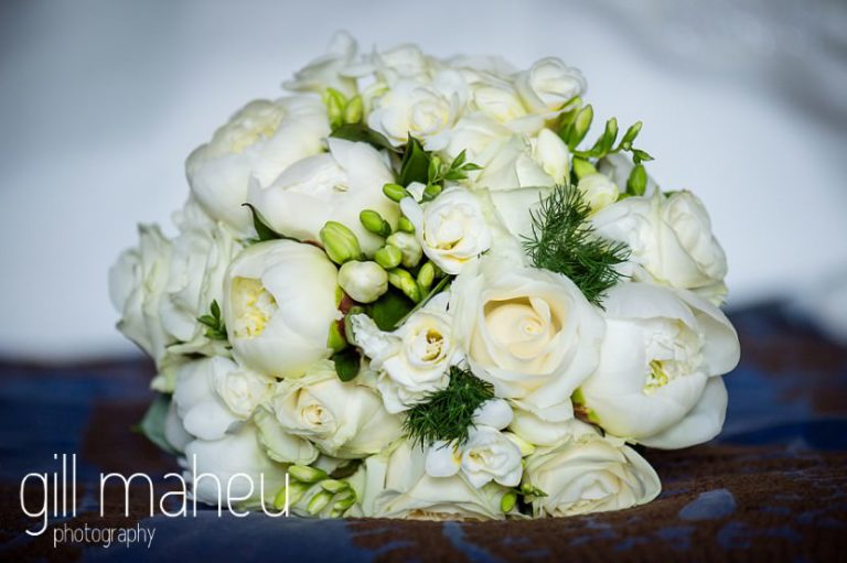 close up details of white rose and white peony wedding bouquet at Abbaye de Talloires, Annecy wedding by Gill Maheu Photography, photographe de mariage