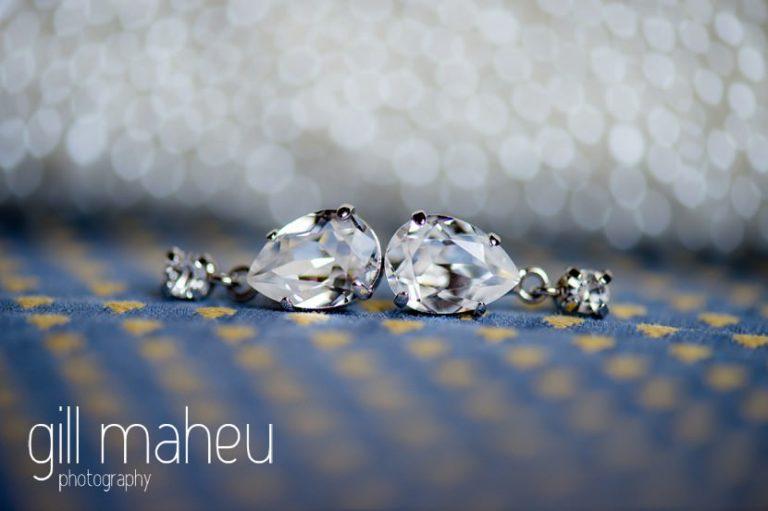 close up of diamond earrings at Abbaye de Talloires, Annecy wedding by Gill Maheu Photography, photographe de mariage