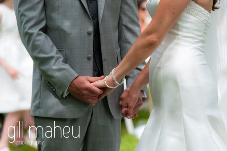 bride and groom holding hands during their beautiful wedding ceremony at Abbaye de Talloires, Annecy wedding by Gill Maheu Photography, photographe de mariage