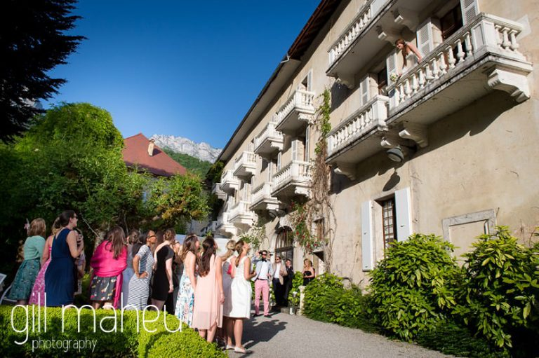 all the single ladies waiting for the wedding bouquet toss from balcony of the bridal suite at Abbaye de Talloires, Annecy wedding by Gill Maheu Photography, photographe de mariage
