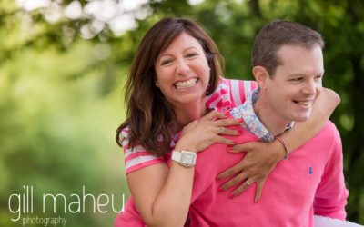 close up of engaged couple laughing at Golf du Lac d'Annecy, Talloires engagement session by Gill Maheu Photography, photographe de mariage