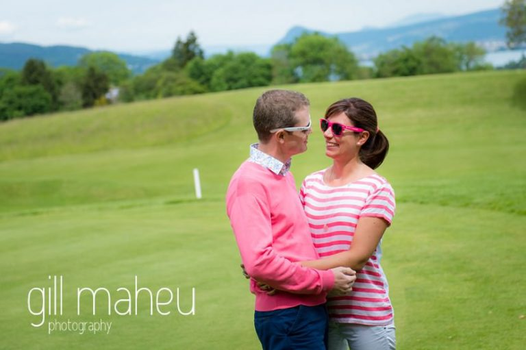 happy couple staring into each others eyes on course at Golf du Lac d'Annecy, Talloires engagement session by Gill Maheu Photography, photographe de mariage