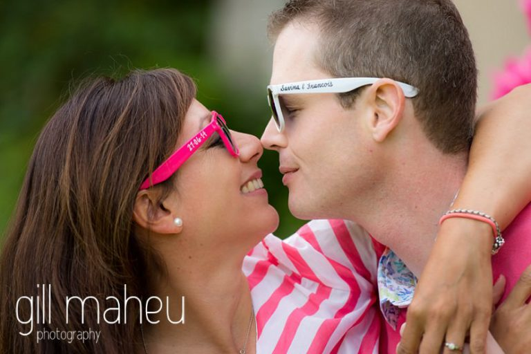 wedding couple with their customised sunglasses about to kiss on Golf du Lac d'Annecy, Talloires engagement session by Gill Maheu Photography, photographe de mariage