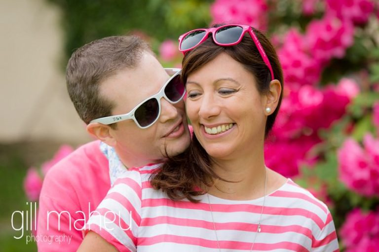 groom to be about to kiss fiancée with their customised sunglasses on Golf du Lac d'Annecy, Talloires engagement session by Gill Maheu Photography, photographe de mariage