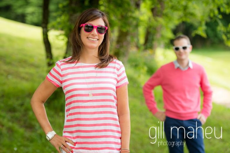 portrait of bride to be with groom in background on Golf du Lac d'Annecy, Talloires engagement session by Gill Maheu Photography, photographe de mariage