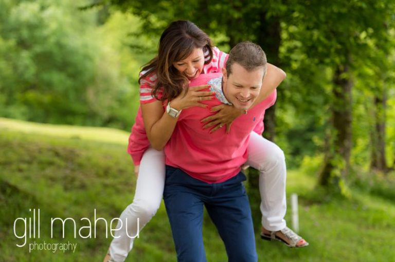 portrait of bride jumping on groom on Golf du Lac d'Annecy, Talloires engagement session by Gill Maheu Photography, photographe de mariage