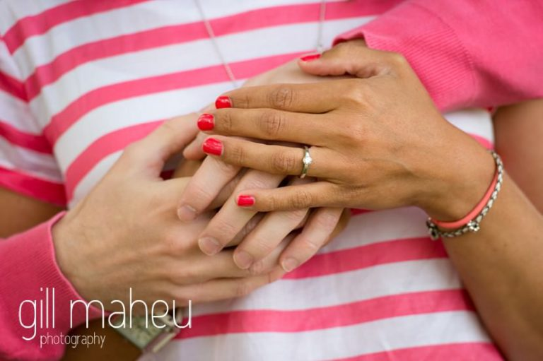 close up shot of engaged couples hand and diamon engagement ring on Golf du Lac d'Annecy, Talloires engagement session by Gill Maheu Photography, photographe de mariage