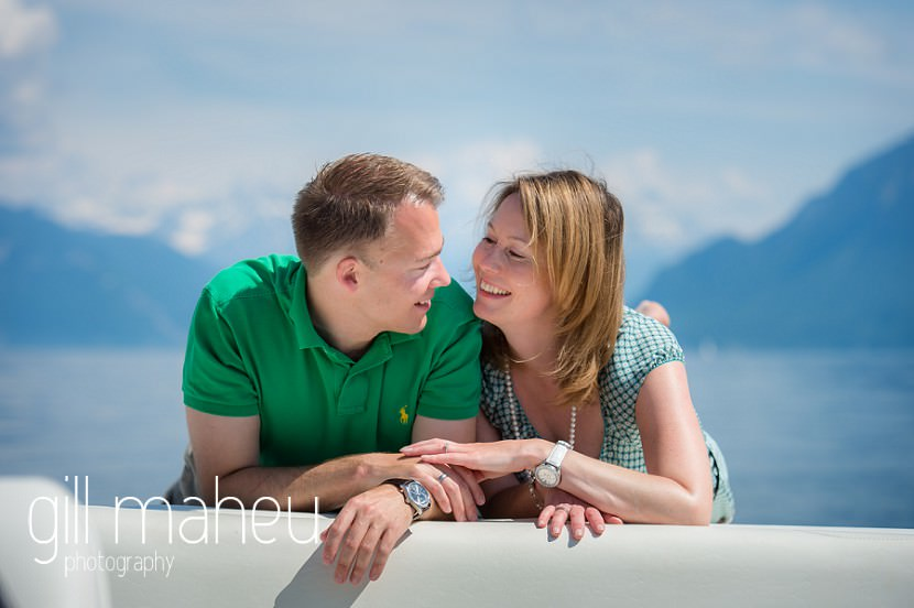 newly engaged couple head to head lying on speed boat on Lac Léman, Lausanne engagement session by Gill Maheu Photography, photographe de mariage