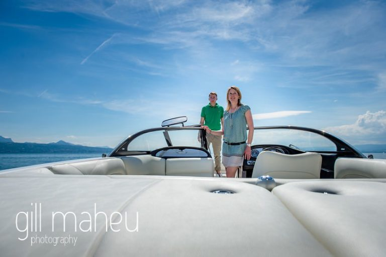 wide shot of bride and groom on speed boat on Lac Léman, Lausanne engagement session by Gill Maheu Photography, photographe de mariage