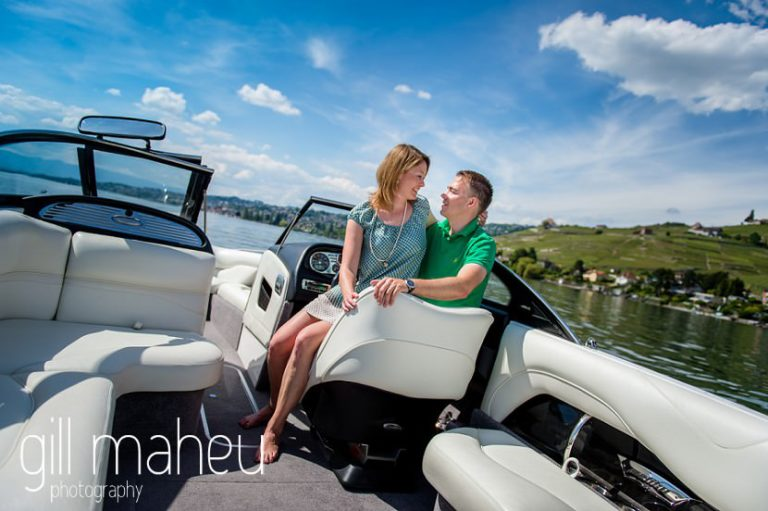 bride sitting on groom's knees on speed boat on Lac Léman, Lausanne engagement session by Gill Maheu Photography, photographe de mariage