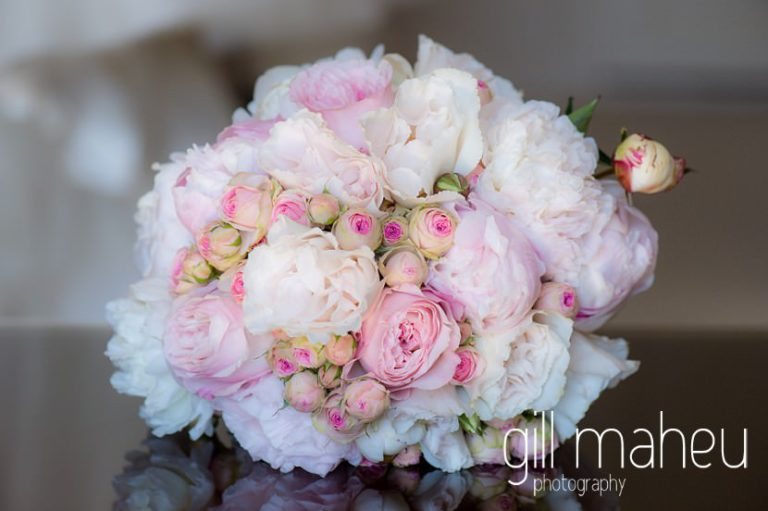 wedding details of beautiful pink rose and peony bouquet at luxury hotel Trois Couronnes, Vevey, Lake Geneva wedding by Gill Maheu Photography, photographe de mariage