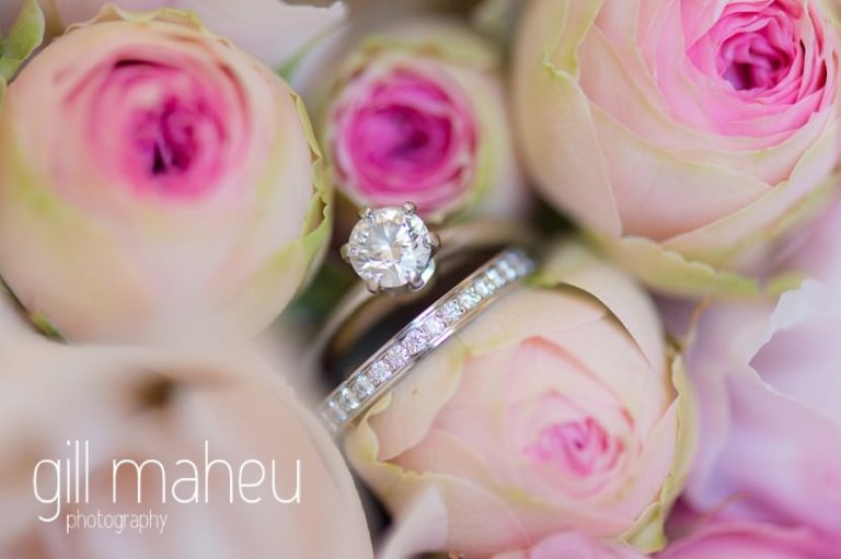 close up of diamond wedding rings in beautiful rose bouquet at luxury hotel Trois Couronnes, Vevey, Lake Geneva wedding by Gill Maheu Photography, photographe de mariage