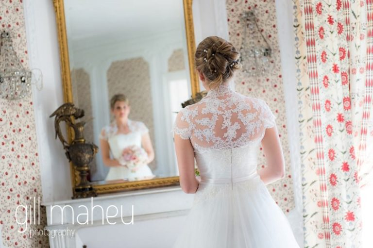 bride looking at herself in the mirror at suite in hotel Trois Couronnes, Vevey, Lake Geneva wedding by Gill Maheu Photography, photographe de mariage
