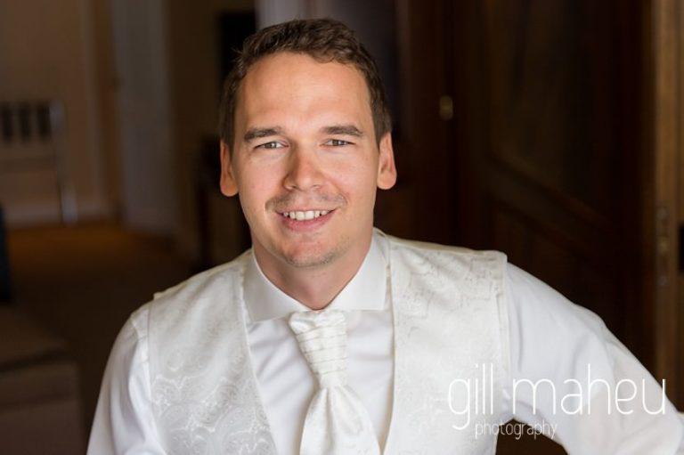 portrait of the groom before hotel Trois Couronnes, Vevey, Lake Geneva wedding by Gill Maheu Photography, photographe de mariage
