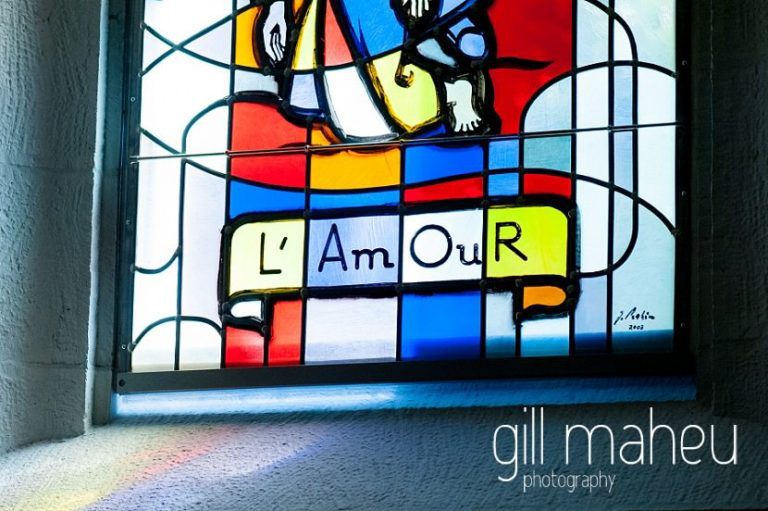 detail from church window in wedding ceremony in Lutry before hotel Trois Couronnes, Vevey, Lake Geneva wedding by Gill Maheu Photography, photographe de mariage