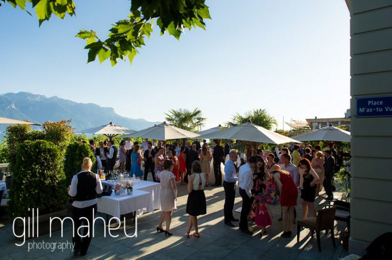 vin d'honneur wedding cocktail in the evening sunshine on the terrace of the luxury hotel Trois Couronnes, Vevey, Lake Geneva wedding by Gill Maheu Photography, photographe de mariage