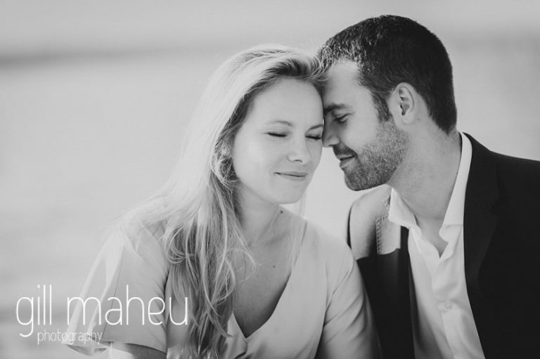 black and white of future bride and groom heads together eyes closed on Geneva engagement session by Gill Maheu Photography, photographe de mariage