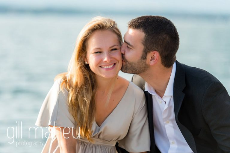 future bride and groom heads together in beautiful golden evening light near Lac Léman on Geneva engagement session by Gill Maheu Photography, photographe de mariage