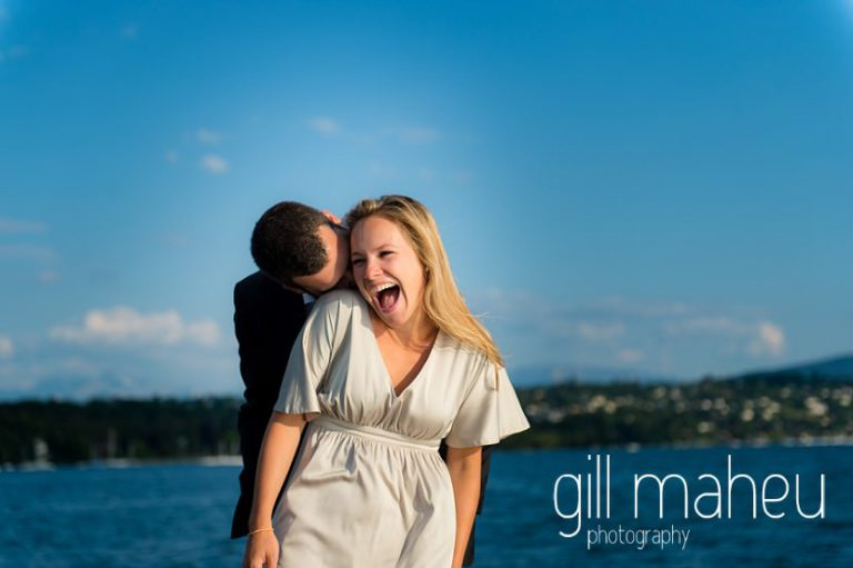gorgeous couple laughing together on speed boat on Lac Léman in golden light, Geneva engagement session by Gill Maheu Photography, photographe de mariage