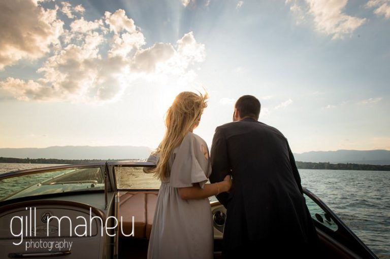 engaged couple staring into setting sun on speed boat on Lac Léman, Geneva engagement session by Gill Maheu Photography, photographe de mariage