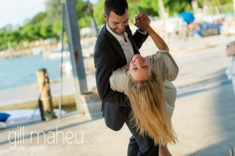 engaged couple practising the dip from their first dance in boathouse on the shore of on shore of Lac Léman, Geneva engagement session by Gill Maheu Photography, photographe de mariage