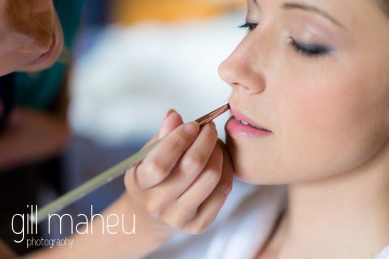 finishing touches to bridal make up by Make You Up in the suite nuptiale Jena Reno at Abbaye de Talloires, Annecy wedding by Gill Maheu Photography, photographe de mariage