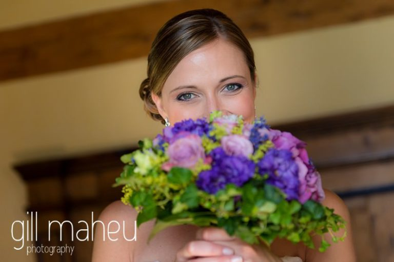 bridal portrait of bride peeking out from behind her bouquet in the suite nuptiale Jena Reno at Abbaye de Talloires, Annecy wedding by Gill Maheu Photography, photographe de mariage