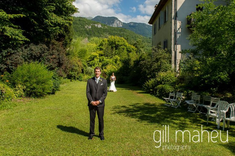 first look, groom waiting for his bride in the gardens of the Abbaye de Talloires, Annecy wedding by Gill Maheu Photography, photographe de mariage