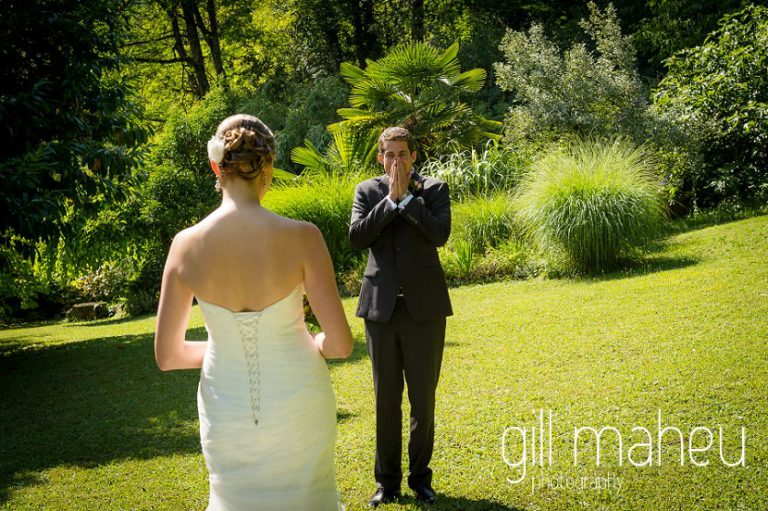 groom's reaction as he sees his bride for the first time at their first look in the gardens of the Abbaye de Talloires, Annecy wedding by Gill Maheu Photography, photographe de mariage