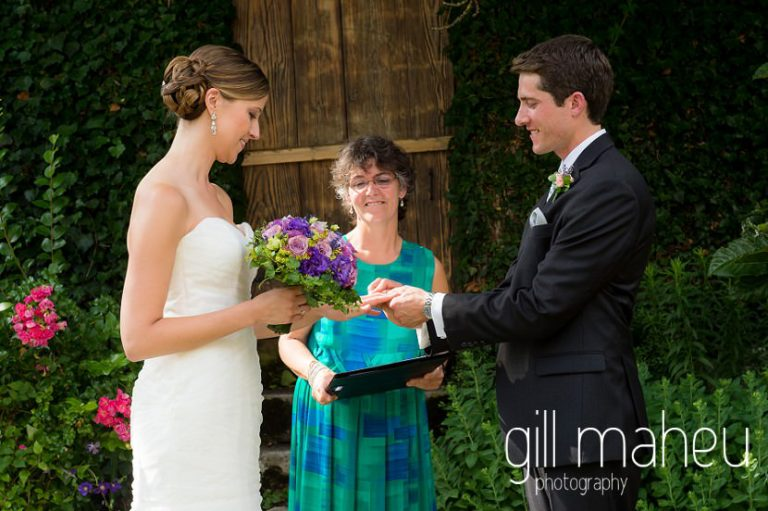 bride and groom exchanging rings outside wedding ceremony in the gardens of the Abbaye de Talloires, Annecy wedding by Gill Maheu Photography, photographe de mariage