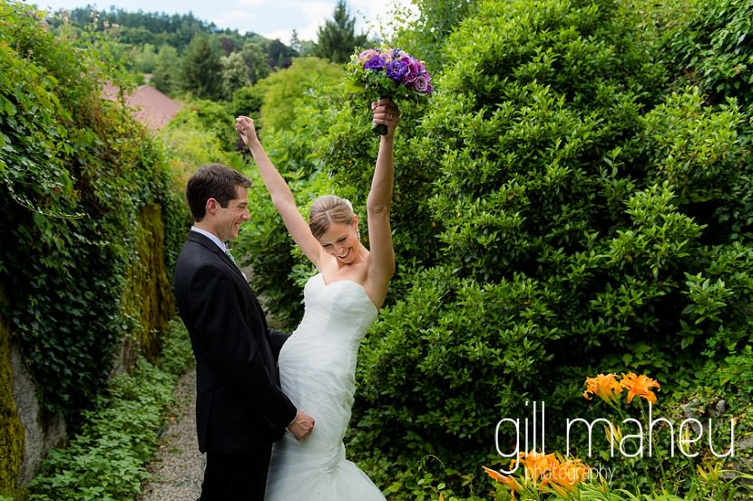 bride and groom celebrating in the grounds of the Abbaye de Talloires, Annecy wedding  by Gill Maheu Photography, photographe de mariage