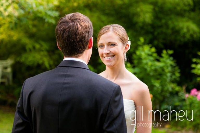 wedding couple smiling at each other in the gardens of the Abbaye de Talloires, Annecy wedding by Gill Maheu Photography, photographe de mariage