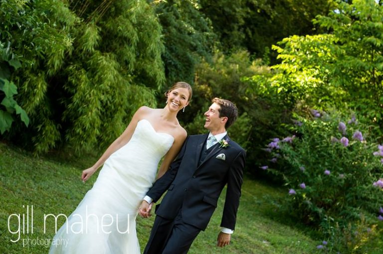 bridal couple walking towards the camera in portraits of the happy couple in the gardens of the Abbaye de Talloires, Annecy wedding by Gill Maheu Photography, photographe de mariage