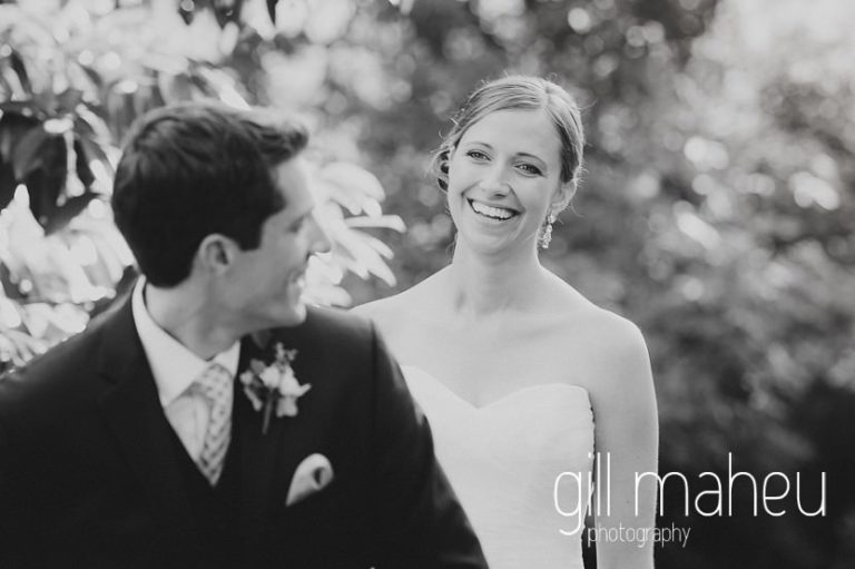 black and white portrait of the bride standing behind the groomportraits of the happy couple in the gardens of the Abbaye de Talloires, Annecy wedding by Gill Maheu Photography, photographe de mariage
