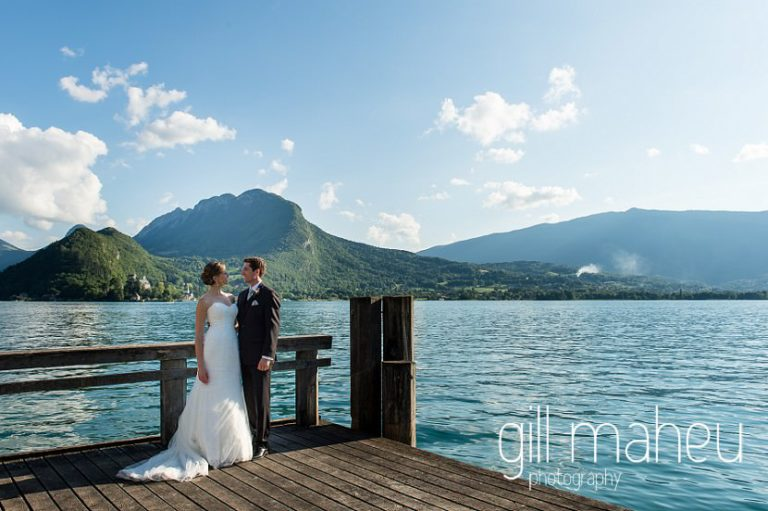bride and groom on the ponton jetty in Talloires at their Abbaye de Talloires, Annecy wedding by Gill Maheu Photography, photographe de mariage
