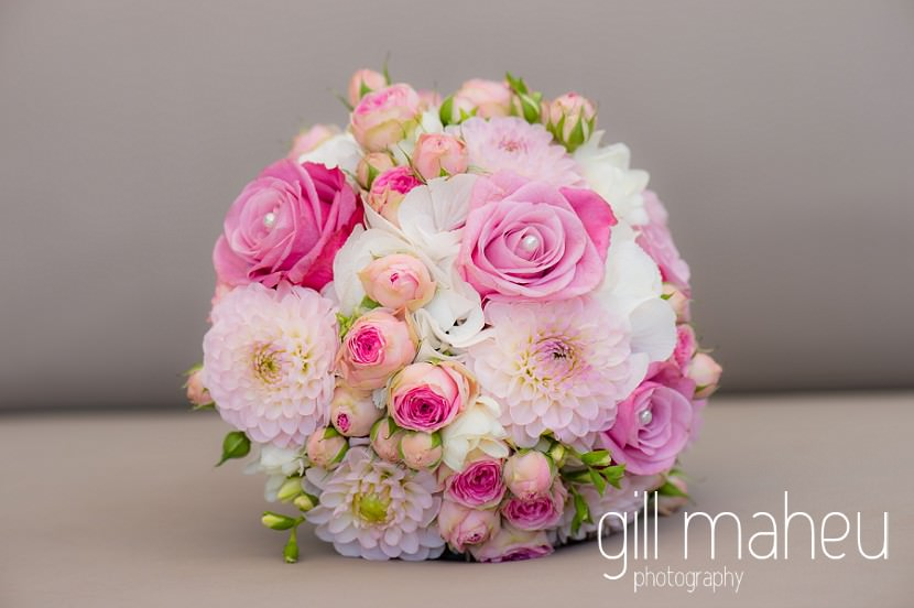 wedding details of beautiful rose and chrysanthemum wedding bouquet on the terrace at the Fairmont Le Montreux Palace, Lake Geneva wedding by Gill Maheu Photography, photographe de mariage