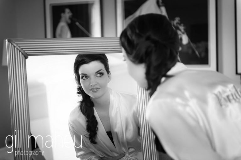 black and white of bride looking into mirror during bridal preparations  in the Freddie Mercury Suite at the Fairmont Le Montreux Palace, Lake Geneva wedding by Gill Maheu Photography, photographe de mariage