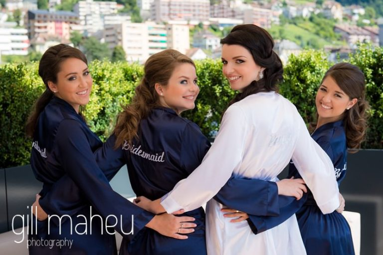 bride and bridesmaids in matching dressing gowns on the terrace at the Fairmont Le Montreux Palace, Lake Geneva wedding by Gill Maheu Photography, photographe de mariage