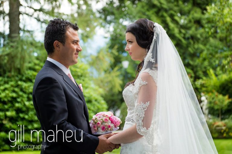 bride and groom head to head in gardens at Fairmont Le Montreux Palace, Lake Geneva wedding by Gill Maheu Photography, photographe de mariage