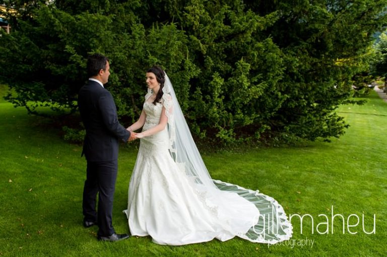 full length portrait of bride and groom holding hands in gardens at  Fairmont Le Montreux Palace, Lake Geneva wedding by Gill Maheu Photography, photographe de mariage