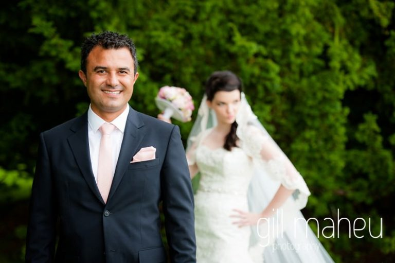 portrait of groom with bride in background at Fairmont Le Montreux Palace, Lake Geneva wedding by Gill Maheu Photography, photographe de mariage